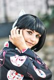 Anime girl with a black hair. In asian background stock photo