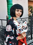 Anime girl with a black hair. In asian background stock image