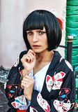 Anime girl with a black hair. In asian background stock photography