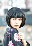 Anime girl with a black hair. In asian background royalty free stock photo