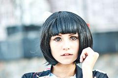 Anime girl with a black hair. In asian background royalty free stock images