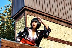 Anime girl with a black hair. In asian background royalty free stock image