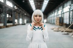 Anime girl, blonde woman with makeup. Cosplay, japanese culture, doll in dress on abandoned factory stock images