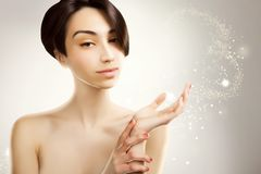 Anime looking japanese model for beauty advertisement, grey spa royalty free stock images
