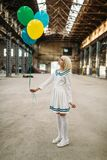 Anime style blonde lady with colorful air balloons. Pretty anime style blonde lady with colorful air balloons. Cosplay fashion, asian culture, doll in dress stock image