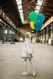 Anime style blonde lady with colorful air balloons royalty free stock photo