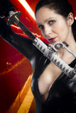 Anime stylized sexy brunette with holding a katana sword with tw Royalty Free Stock Image
