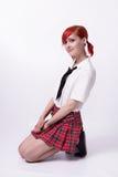 Animeflicka i kort kjol på en vit bakgrund royaltyfria bilder