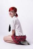 Animeflicka i kort kjol på en vit bakgrund Arkivbilder