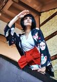 Animemädchen mit einem schwarzen Haar stockfoto