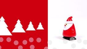 Animering av julträd i snöfall och en korsning för Santa Claus windupdocka igenom royaltyfri illustrationer