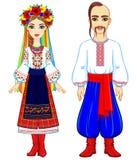 Animeringstående av den ukrainska familjen i nationell kläder full tillväxt Arkivbilder