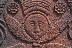 Anioł twarz rzeźbiąca w czerwonym piaskowu Obrazy Royalty Free