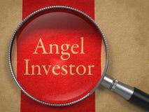 Anioła inwestor Przez Powiększać - szkło zdjęcie stock