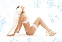 anioły święta dziewczyny patrzeć w górę białych bielizny Obrazy Royalty Free