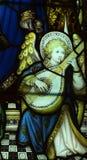Anioł robi muzyce w witrażu Zdjęcie Royalty Free