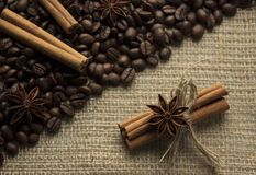 Anis and cinammon. Near cofee beans on sackcloth Royalty Free Stock Images