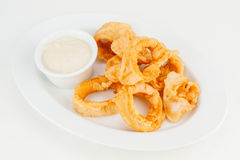 Anéis do calamar no tempura friável Foto de Stock