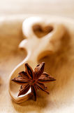 Anis star in heart shape wooden spoon Royalty Free Stock Image