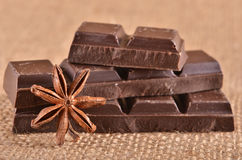 Anise and chocolate pieces on the burlap Royalty Free Stock Images