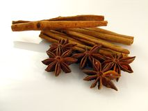 Anise & Cinnamon. Sticks of cinnamon and stars of anise on the white background Stock Photo