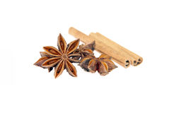 Anise and cinnamon. Anise stars and cinnamon sticks isolated on white Royalty Free Stock Images