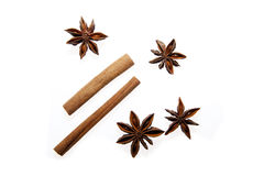 Anise and cinnamon. Anise stars and cinnamon sticks isolated on white Royalty Free Stock Photos