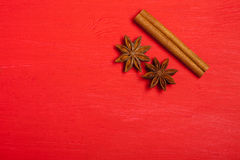 Anise and cinnamon spices on christmas red background, top view Stock Image