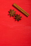 Anise and cinnamon spices on christmas red background, top view Stock Photo