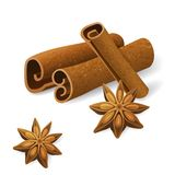 Anise and cinnamon. Anise stars and cinnamon sticks over white background Royalty Free Stock Image