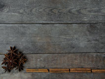 Anise and cinnamon sticks on wooden background.  Royalty Free Stock Photography