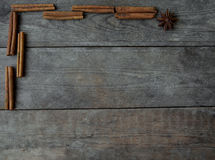 Anise  and cinnamon sticks on wooden background.  Stock Photos
