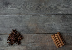 Anise and cinnamon sticks on wooden background.  Stock Photography