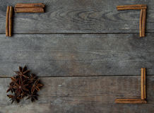 Anise and cinnamon sticks on wooden background.  Royalty Free Stock Photos
