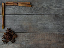 Anise and cinnamon sticks on wooden background.  Royalty Free Stock Photo