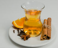 Anise, clove, orange, cinnamon and tea Royalty Free Stock Photos