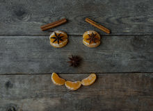 Anise mandarin  and cinnamon sticks on wooden background.  Royalty Free Stock Photo