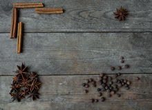 Anise pepper and cinnamon sticks on wooden background.  Royalty Free Stock Images