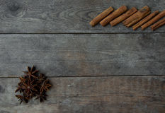 Anise pepper and cinnamon sticks on wooden background.  Royalty Free Stock Image