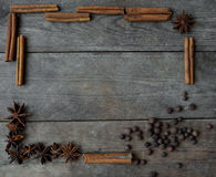 Anise pepper and cinnamon sticks on wooden background.  Stock Photos