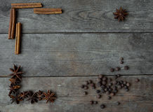 Anise pepper and cinnamon sticks on wooden background Stock Photography