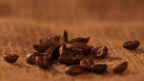 Anise on sacking, and falling coffee beans, close stock footage
