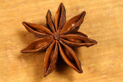 Anise star. A single anise star on the wooden background. Christmas time Royalty Free Stock Photography