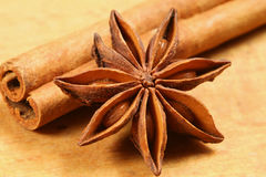 Anise star. And cinnamon stick on wooden background. Christmas ingredients Stock Photo