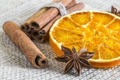 Anise star and cassia cinnamon sticks with dried orange ring Stock Photos