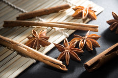Anise-star and cinnamon stick on bamboo mat. Stock Photography