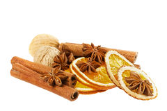 Anise star, cinnamon sticks, walnut and dried orange isolated on white background Stock Photography