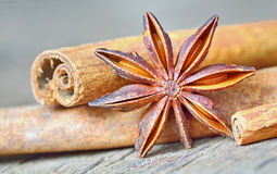 Anise star and cinnamon sticks, on wooden table Stock Image