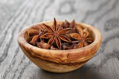Anise stars in bowl on old oak table close up Royalty Free Stock Photos