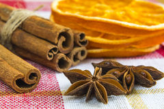 Anise stars and cassia cinnamon sticks with dried orange rings Stock Photos